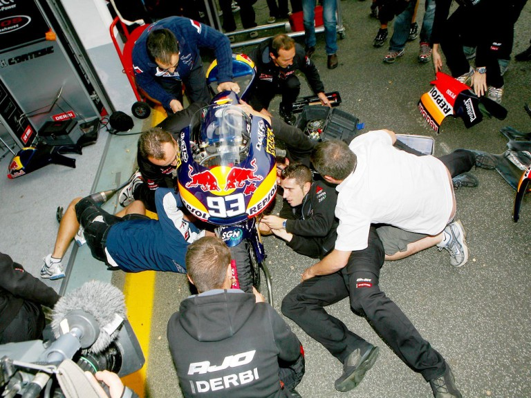 Red Bull Ajo Motorsport staff working on Márquez's bike at Estoril