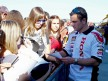 Randy de Puniet attending fans at the paddock in Valencia