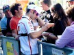 Marco Melandri attending fans at the paddock in Valencia