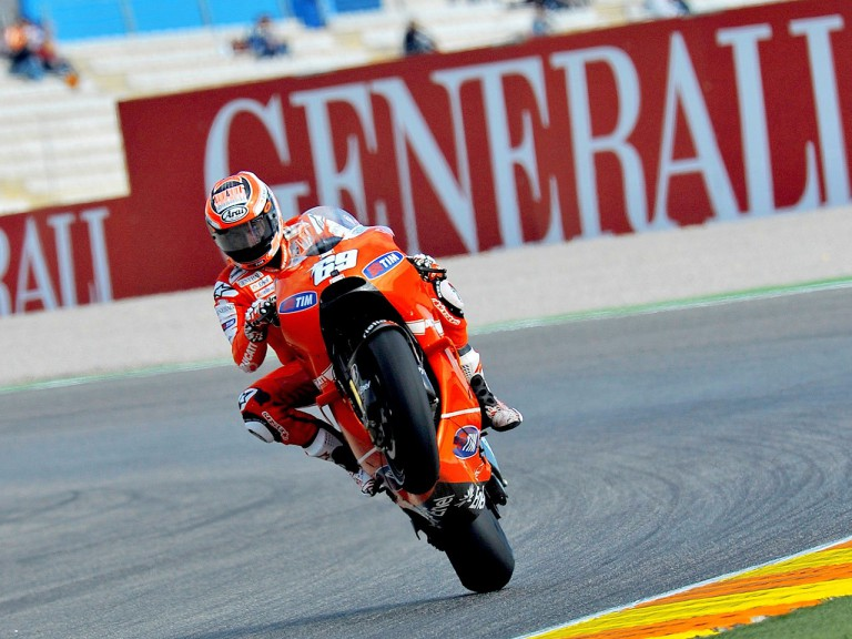 Nicky Hayden pulls off a wheelie in Valencia