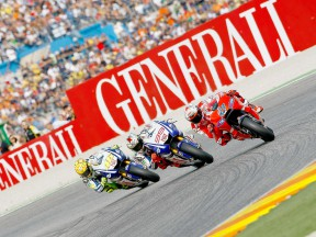Stoner, Lorenzo and Rossi in action in Valencia