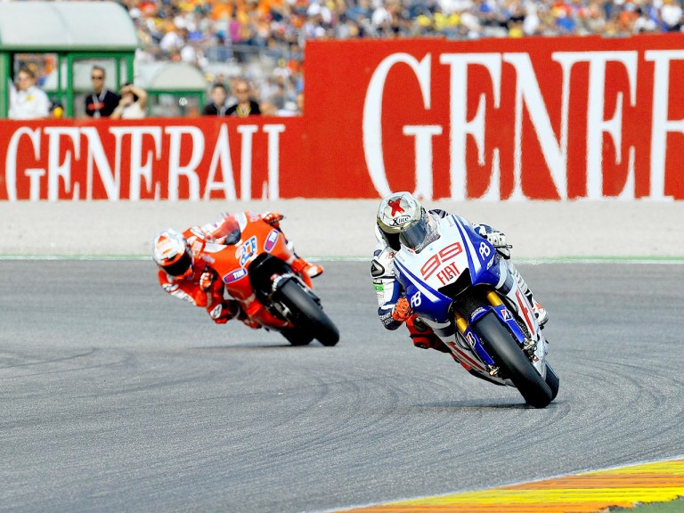 Lorenzo riding ahead of Stoner in Valencia