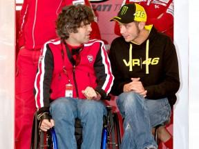 Filippo Preziosi and Valentino Rossi in the Ducati garage at Valencia test