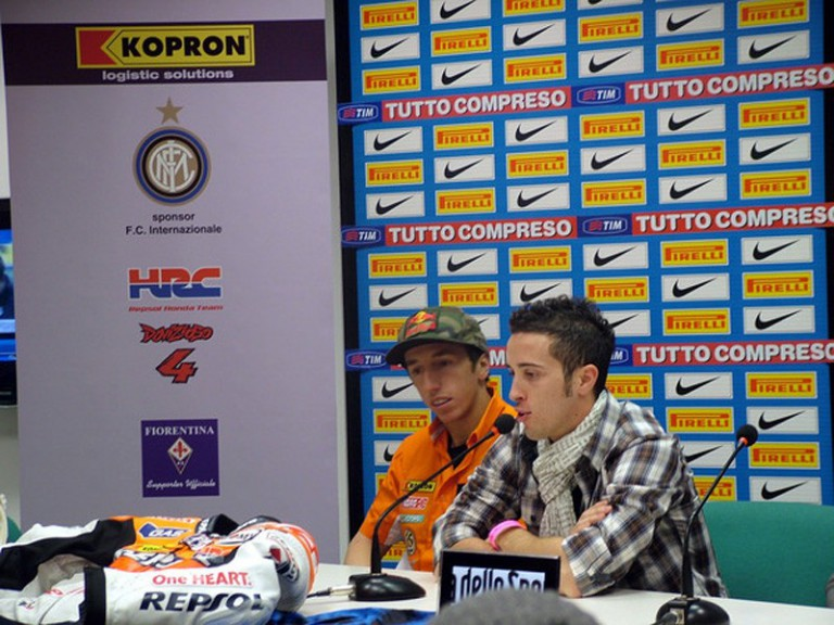 Andrea Dovizioso and Tony Cairoli at the San Siro stadium