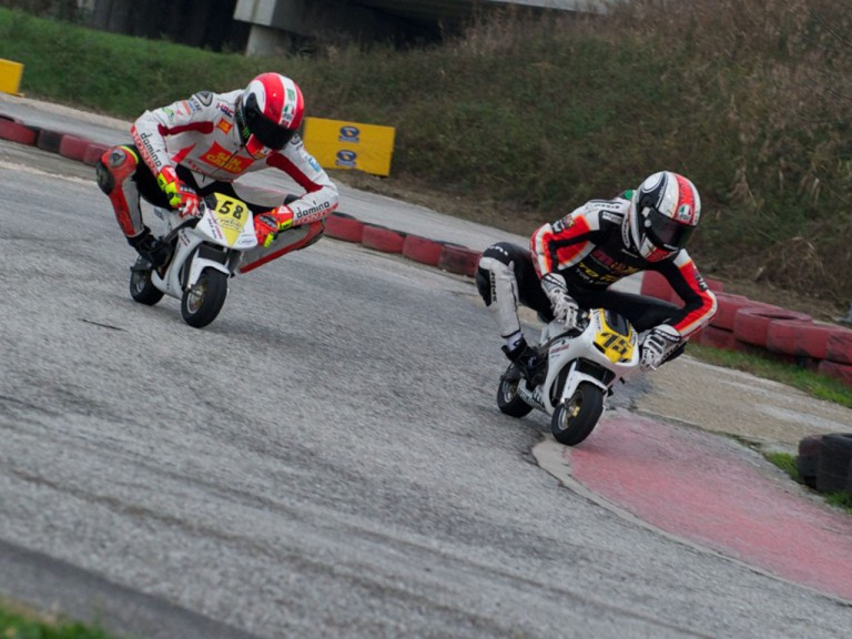 Simoncelli and Pasini racing mini-motos for charity