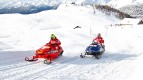 Rossi and Hayden ride snowmobiles at Madonna di Campiglio