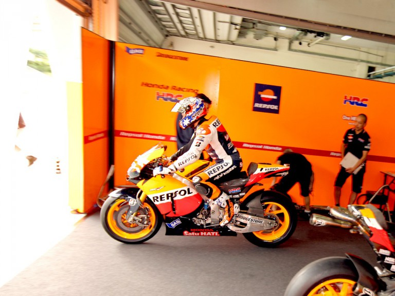 Casey Stoner leaving the Repsol Honda garage in the Sepang test