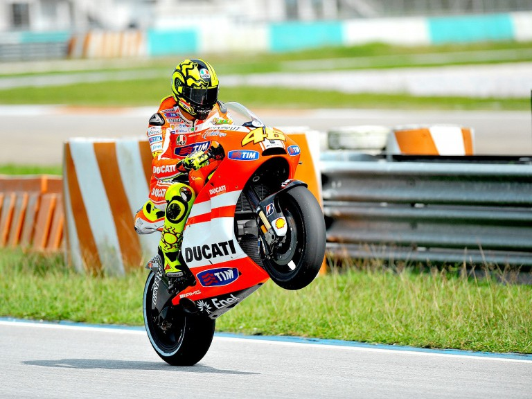 Valentino Rossi pulls off a wheelie at the Sepang test