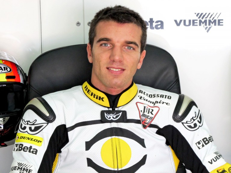 Alex de Angelis in the JIR Moto2 garage