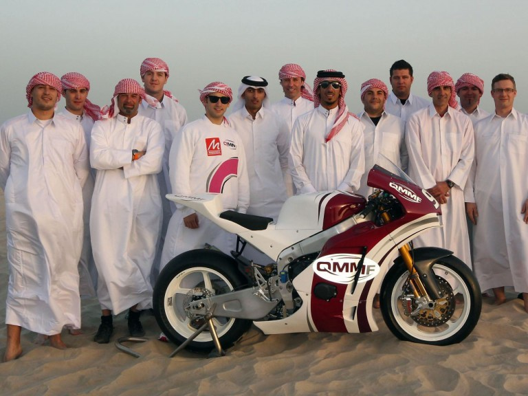 The QMMF Racing Team line up on Qatari sand
