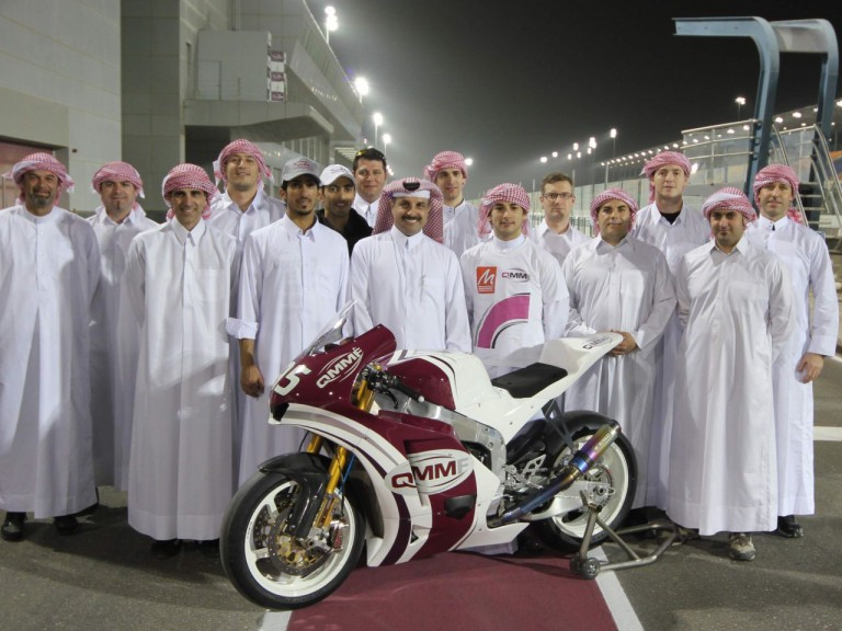 The QMMF Racing Team line up on the Losail circuit