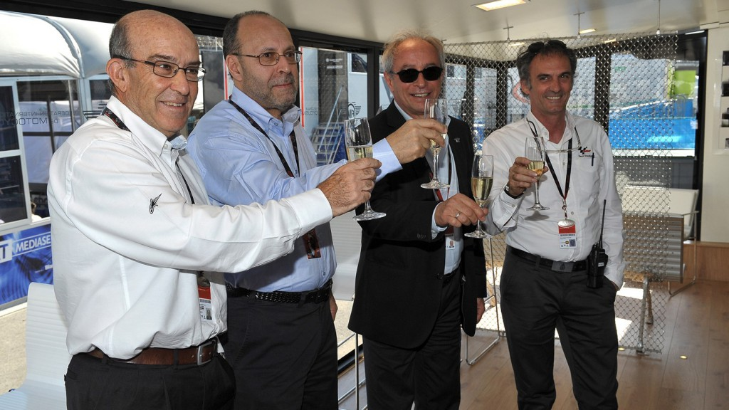 Carmelo Ezpeleta (Dorna Sports CEO), Guy Maitre (FIM Chief Executive Officer), Vito Ippolito (FIM President), Franco Uncini