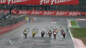 Stefan Bradl (Viessmann Kiefer Racing) wins the AirAsia British Grand Prix Moto2 race, with British rider Bradley Smith (Tech 3) crossing the wet finish line in second and Michele Pirro (Gresini Racing Moto2) in third.