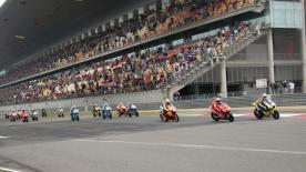 Italian imposes pace to beat Dani Pedrosa and Casey Stoner to MotoGP victory.