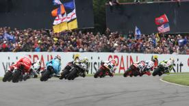Repsol Honda rider bests Colin Edwards and Randy de Puniet in British Grand Prix.