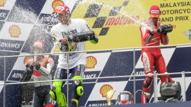 Valentino Rossi finished third behind Casey Stoner and Dani Pedrosa at a rain-soaked Sepang to take the 2009 MotoGP World Championship title.