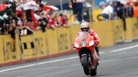 Casey Stoner is the new MotoGP World Champion after he finished sixth at the A-Style Grand Prix of Japan on a great day for Ducati Marlboro, with the Australian's colleague Loris Capirossi completing a hat-trick of Motegi wins.