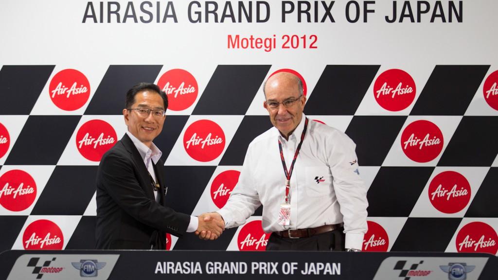 Mobilityland Corp President Hiroshi Soda, Dorna Sports CEO Carmelo Ezpeleta, Motegi
