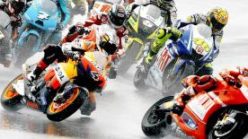 Spaniard takes stunning win from Rossi and Pedrosa.