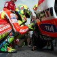 Rossi leads timings in damp MotoGP warm