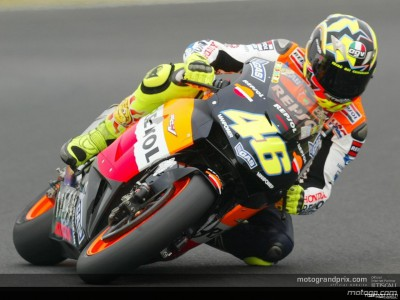 Rain blots action as Rossi takes control