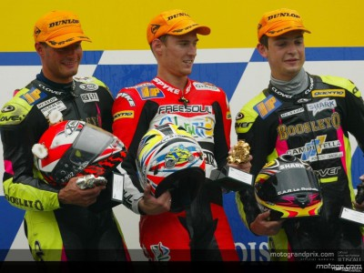 Views from the top three after the 250cc race in a wet Assen