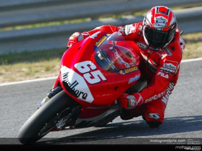 Capirossi sets pole record as Italians stamp authority on Portugal