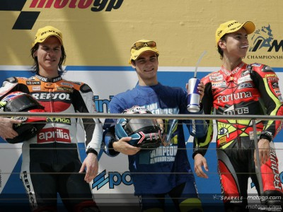 Pedrosa secures 250cc title with photo-finish win