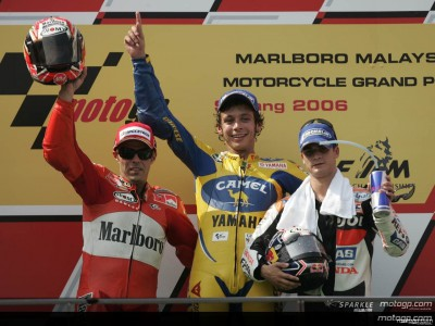Rossi takes victory after another epic battle with Capirossi