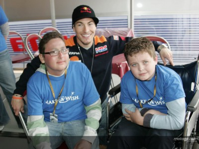 Young trio enjoy a day with the champion