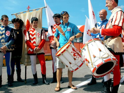 MotoGP stars fly the flag with local performers