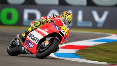 Rossi leads timings in damp MotoGP warm