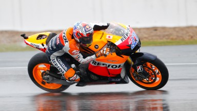 Stoner sets the pace in the rain