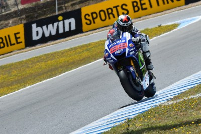 Lorenzo sets new lap record to claim pole