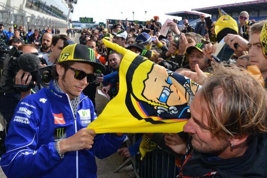 Valentino Rossi attending fans