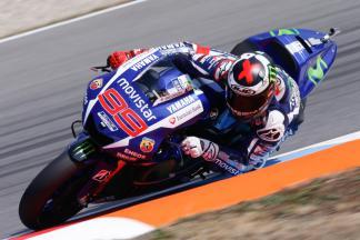 Lorenzo destroys lap record to take pole