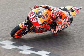 Marquez romps to pole position