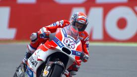 Andrea Dovizioso took advantage of a drying track to claim his first pole position since Qatar in 2015 ahead of Valentino Rossi and Scott Redding.