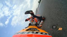 Repsol Honda rider slides off at Turn 1 before a special escort back to the garage