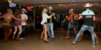 Honky Tonk men: riders dance the Broken Spoke Swing in Texas