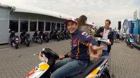 Go behind the scenes of a MotoGP™ paddock, from the first trucks arriving to the lights going out on race day!