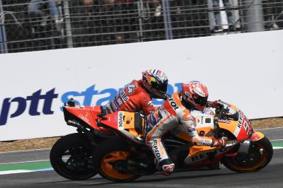 What podiums have been decided on last lap duels?