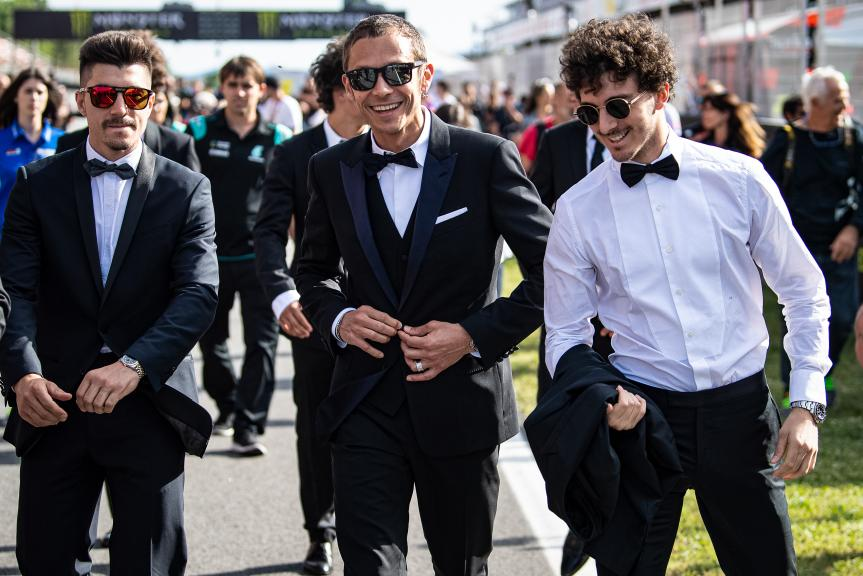 Maverick Vinales, Valentino Rossi, Francesco Bagnaia, MotoGP™ suit up for 70 years celebration