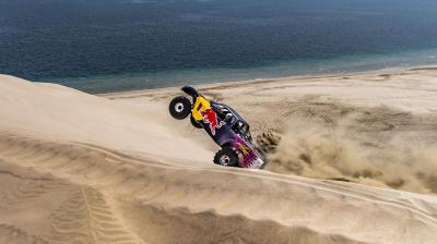 Lorenzo takes on the dunes with Al-Attiyah