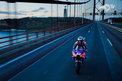 Miguel Oliveira rides his KTM across the 25 de Abril Bridge