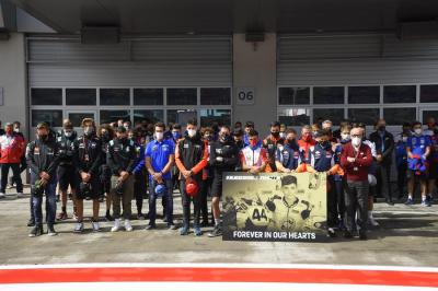 The #MotoGP paddock got together for a minute of silence